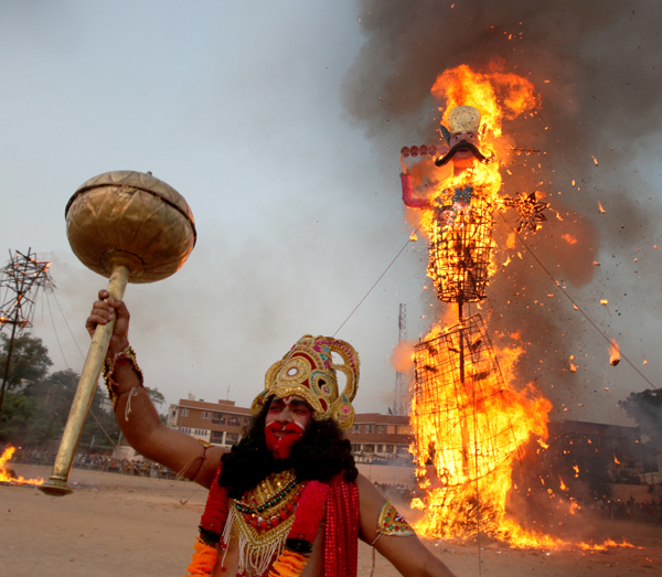 The effigy of demon king Ravana goes into flames during Dussehra celebrations at Parade Ground Jammu on Saturday. —Excelsior/Rakesh