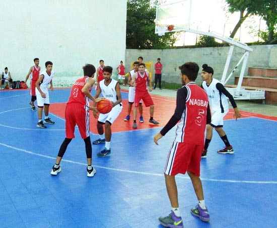 Cagers making moves during Inter School Basketball Tournament.