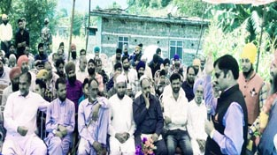MLA Mendhar Javed Rana addressing a public meeting at Mankote on Wednesday.