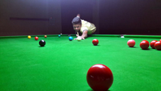 Cueist aiming at target during a sub Junior Snooker match of Six Red Ball Tournament in Jammu on Saturday.
