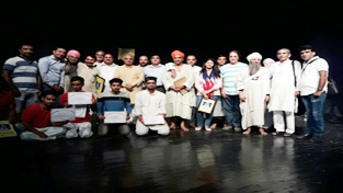 Artists posing for a group photograph after staging play 'Lal Ded' at Abhinav Theatre in Jammu.