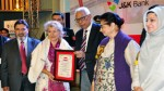 Governor N N Vohra presenting awards to achievers and promoters of Yoga during 2nd International Yoga Festival at Srinagar on Monday.