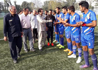 Commissioner Secretary Youth Services and Sports, Hilal Ahmad Parray interacting with footballers in Srinagar on Sunday.