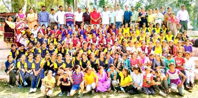 Participants posing along with chief guest and other dignitaries during concluding ceremony of Inter-District Kho-Kho Tournament at Reasi.