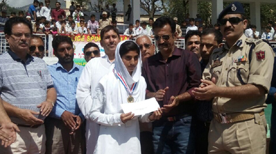 Winner being felicitated by the chief guest during concluding ceremony of Police Sports Festival in Doda.