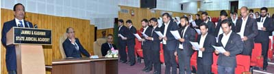 Oath being administered to newly enrolled advocates at Srinagar on Tuesday.