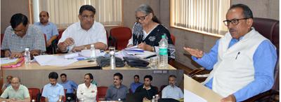 DyCM Dr Nirmal Singh chairing a meeting at Jammu on Saturday.