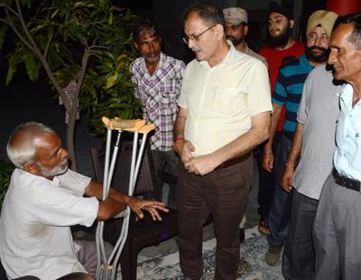 Speaker Kavinder Gupta listening grievances of a disabled person on Saturday.