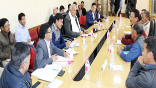 Minister for PHE, Irrigation & Flood Control, Sham Lal Choudhary chairing a meeting at Leh.
