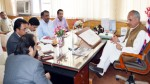 Minister for Revenue, A R Veeri chairing a meeting at Srinagar on Monday.