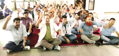 Doctors and Para-Medical staff of D H Reasi staging protest dharna on Wednesday.