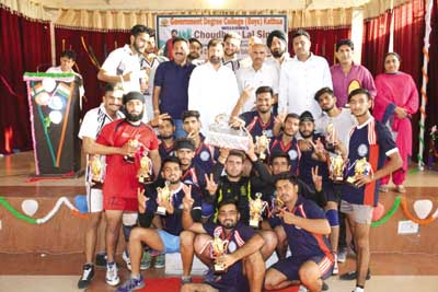 Winning team players posing for photograph with Forest Minister Choudhary Lal Singh and others.