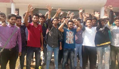 JJSF members raising slogans during protest outside JKCA office in GGM Science College at Jammu on Friday.