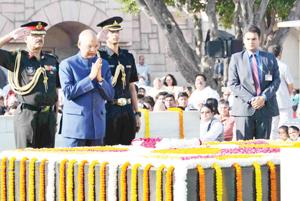 President, Ram Nath Kovind paying homage at the Samadhi of Mahatma Gandhi on his 148th birth anniversary, at Rajghat, in Delhi on Monday.