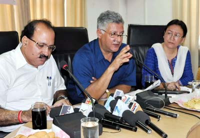 Director Family Welfare, MCH and Immunization Dr Samir Mattoo interacting with media persons at Jammu on Friday. CMO Jammu Dr Sanjay Turki is also seen in the picture. —Excelsior/Rakesh