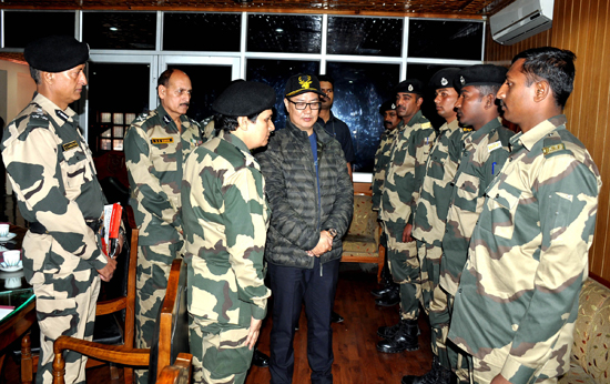 Union Minister of State for Home Affairs Kiren Rijiju interacting with BSF personnel in Srinagar on Saturday. (UNI)