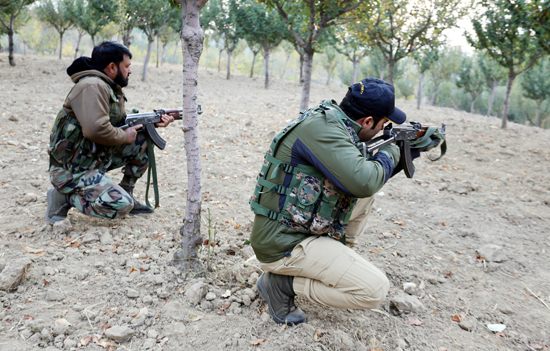 Troops during gunbattle with militants at Handwara on Sunday. —Excelsior/Aabid Nabi