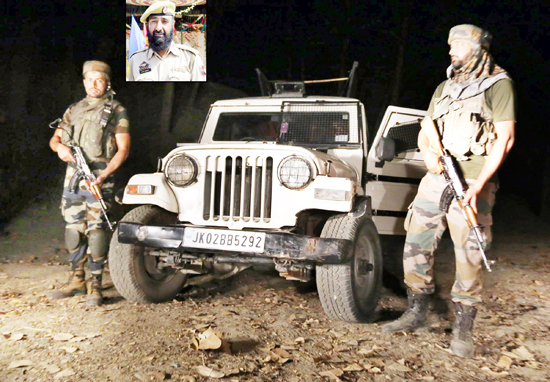 Security forces stand alert at Zuhama area in North Kashmir's Baramulla district after militants lobbed a grenade at police and Army party on Monday evening. (Inset) Cop Aashiq Hussain. -Excelsior/Aabid Nabi