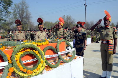BSF officials paying floral tributes to killed ASI at Humhama in Srinagar on Wednesday. (UNI)