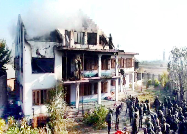Security personnel searching a house in which two militants were killed in Pulwama district on Saturday. Another pic on page 6. —Excelsior/Younis Khaliq