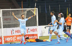 Indian players celebrate after scoring a winning goal against Malaysia in the final at Dhaka on Sunday.