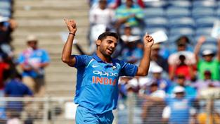 Bhuvneshwar Kumar celebrates the wicket of Colin Munro at Pune on Wednesday.
