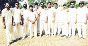 Players of Singh CC Akhnoor posing for a group photograph after beating PSA Jammu in Veteran Cup on Sunday.