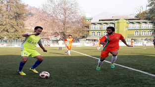 Players in action during State Football League-2017 in Srinagar.