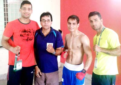 Boxer Pradeep posing along with coach and other dignitaries after entering semifinals of Sr National at Visakhapatnam in Andhra Pradesh.