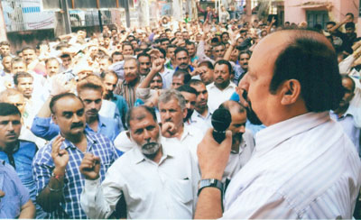 Som Nath, senior vice president of PHE Employees Association addressing a rally at Udhampur on Thursday.