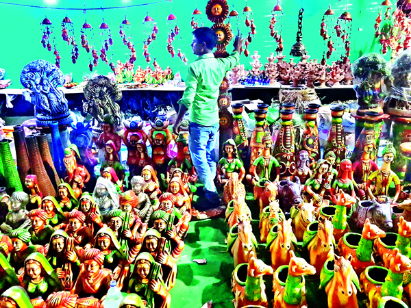 A boy selling docoratives ahead of Diwali festival in Jammu. -Excelsior/Rakesh
