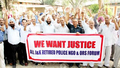 Retired police personnel staging a demonstration in front of Press Club Jammu on Thursday.