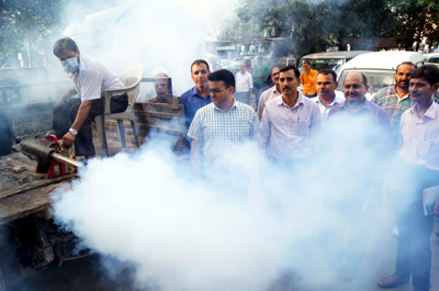 JMC officials during thermal fogging in Jammu city.
