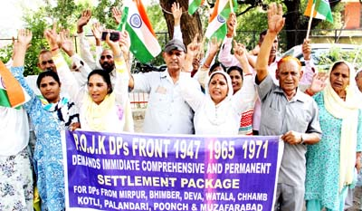 PoJK displaced persons staging protest at Exhibition Ground in Jammu on Thursday. -Excelsior/Rakesh