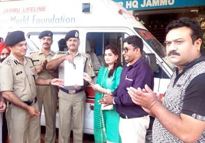 Members of Borderless World Foundation handing over Critical Care Ambulance to BSF Sunderbani at Paloura.