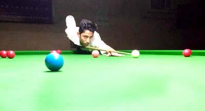 Cueist aiming target at Billiards Hall, MA Stadium in Jammu.