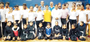 Young players posing for a group photograph along with BJP State President & MLA Jammu West, Sat Sharma on Monday.