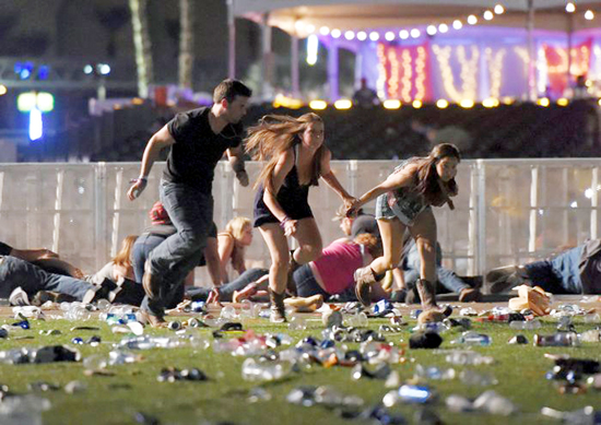 People run from the Route 91 Harvest country music festival after gun fire in Las Vegas.