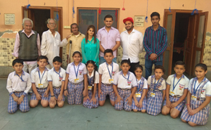 Young artists of Nat Manch posing for group photograph after staging play.