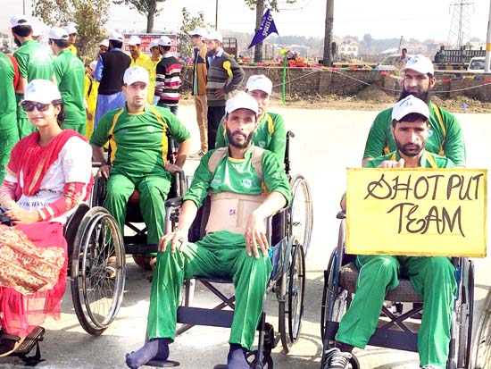 Specially-abled sportspersons in action during mega sports day at Srinagar.