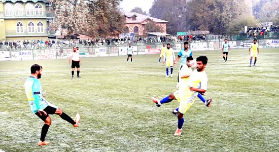 Players in action during a match between J&K Forest and F&S XI in Srinagar.