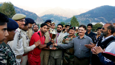 SSP Doda Mohammad Shabir and others presenting trophy to skipper of winner team.