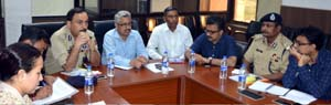 Divisional Commissioner Dr Mandeep Bhandari chairing a meeting on Tuesday.