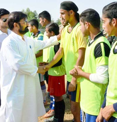 Minister for Forests, Lal Singh interacting with football players in Kathua on Friday.