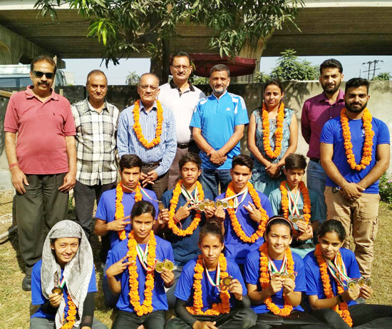 J&K climbers posing for group photograph with dignitaries at Jammu on Tuesday.