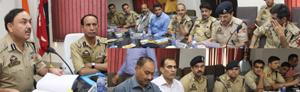 IGP Jammu Dr SD Singh chairing a meeting at PCR Jammu on Thursday.