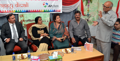 JK Bank Chairman Parvez Ahmed, Chairperson PWWA Bharti Vaid, IGP Shafqat Watali and Zainab Watali at home for specially abled children.