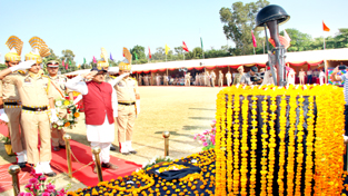 Deputy Chief Minister Dr Nirmal Singh paying tributes to martyrs during Police Commemoration Day function at Gulshan Ground, Jammu on Saturday.