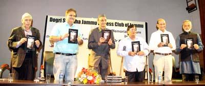 Dr Karan Singh and others releasing Dogri version of Lala Mulk Raj Saraf's autobiography at Jammu on Monday.