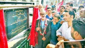 Senior NC leader, Ali Mohd Sagar inaugurating park in Srinagar city on Tuesday.